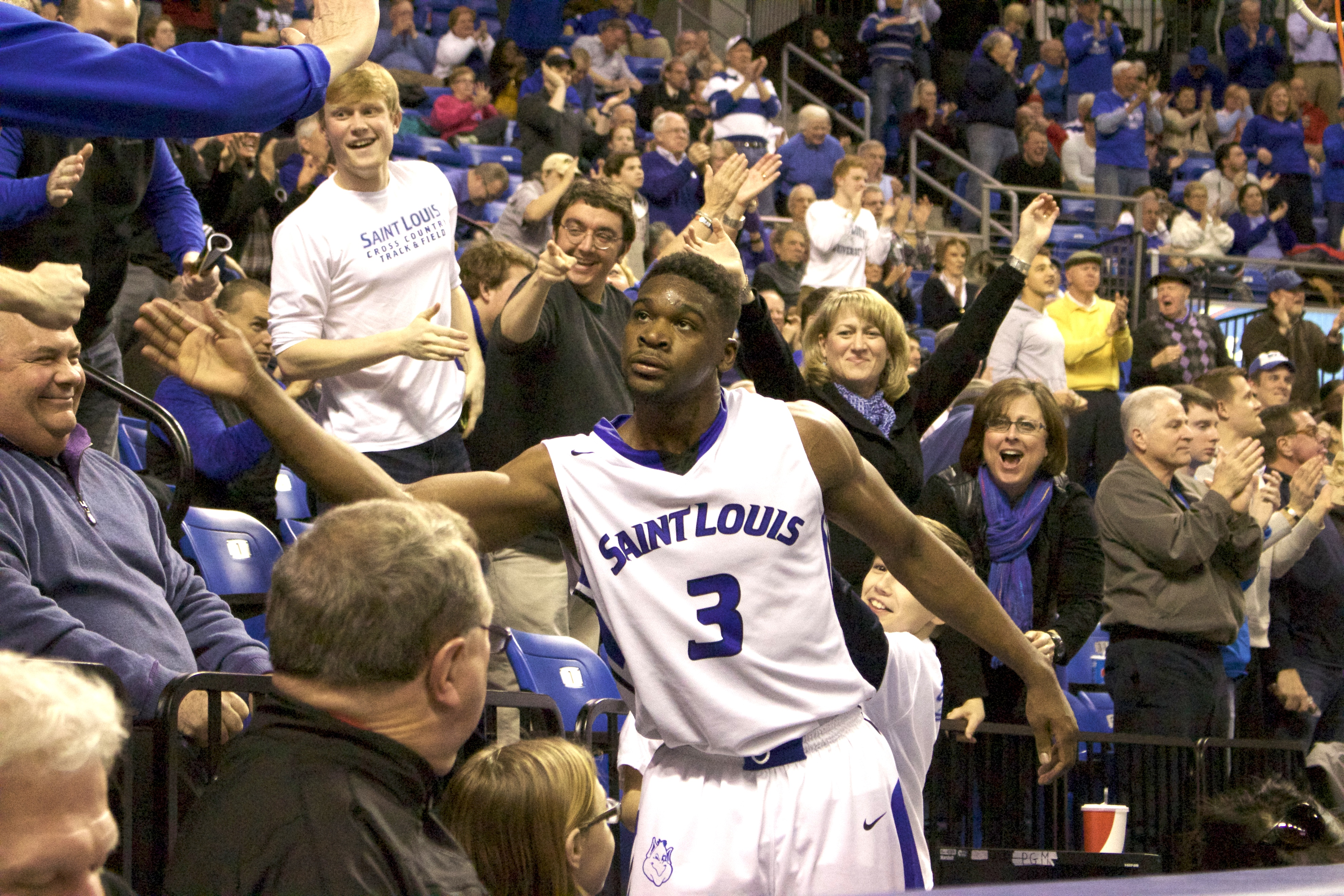 High five: Yacoubou greets a fan after a stellar performance at home against Saint Joseph's, shooting 8-of-10 from the field. Michael DiMaria / Staff Photographer