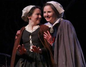 """Salem witch trials: (above) Two SLU graduates perform in """"Afflicted"""" at the Missouri History Museum. Jennifer Theby Quinn portrays Abigail Williams, and Taylor Steward portrays Ann Putnam. (right) Jacqueline Thompson (portraying Tituba) and Emily Jackoway (portraying Betty Parris) share a scene onstage. The play, which is running through March 22, shows what it may have been like to be a girl growing up during the Salem witch trials.  Luke Lindbergh / Metro Theatre Company"""