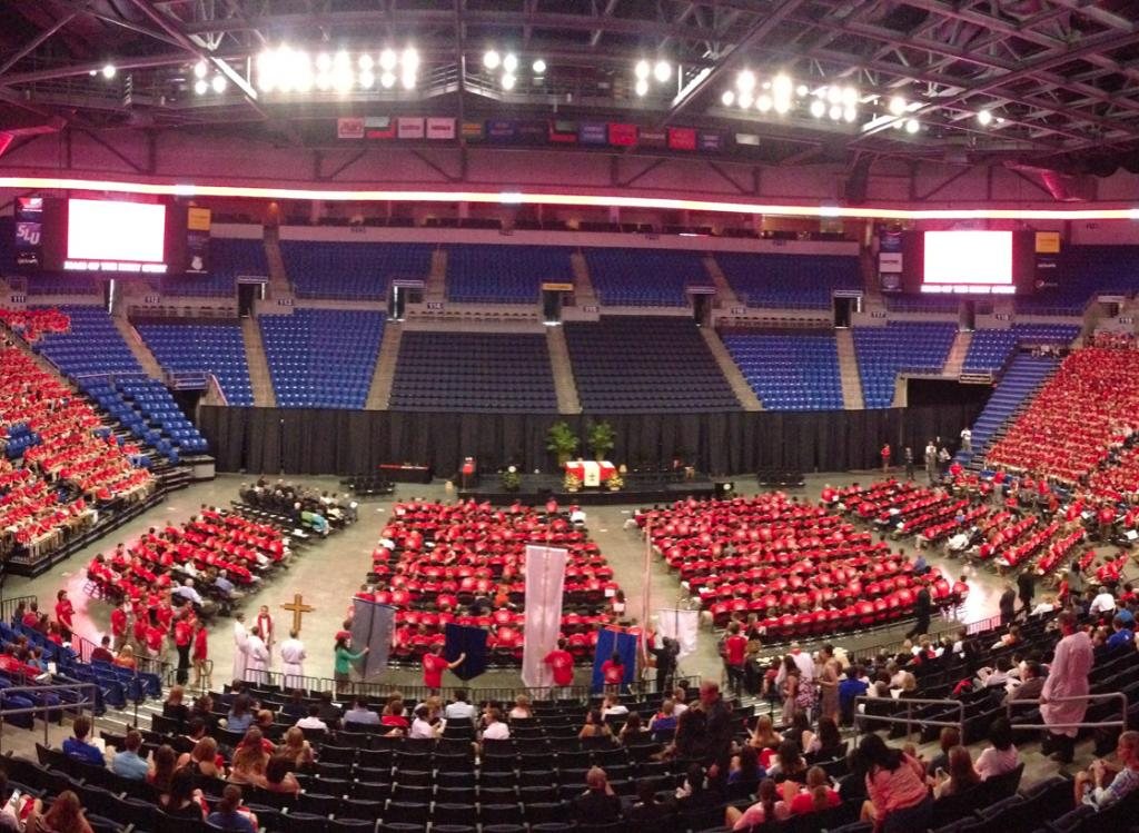 Mass: Students and faculty gather for the Mass of the Holy Spirit at Chaifetz Arena. Max Hammond/ Contributor