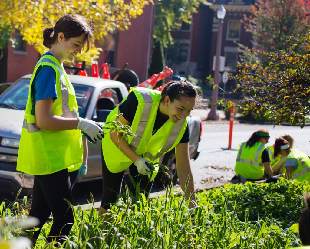 Helping others: Students participate in Make a Difference Day by volunteering throughout the city of St. Louis. Andrew Trinh / Contributor