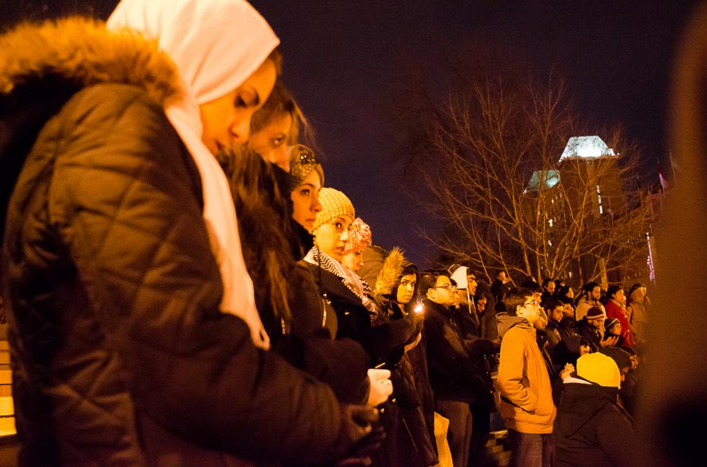 Reflection: Muslim, non-Muslim students gathering at the clocktower while a Quran prayer verse is recited. Ryan Quinn / Photo Editor