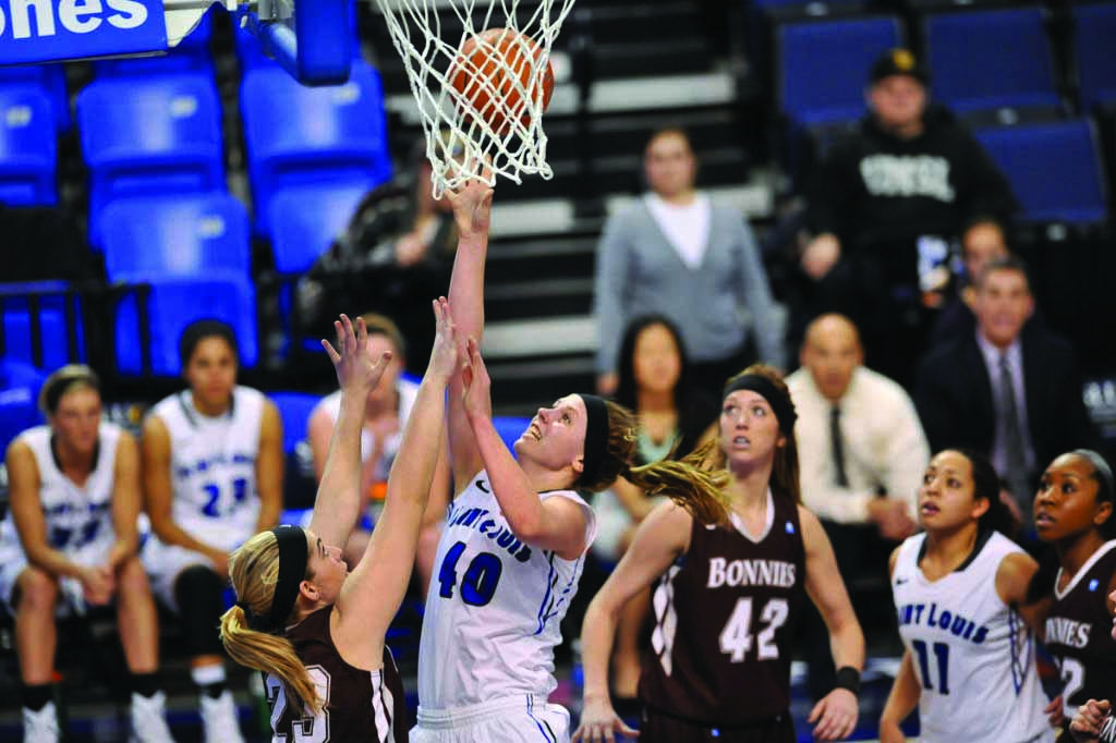 Rebound: Sophomore Center Sadie Stipanovich reaches for the ball. Stipanovich was the A-10 Player of the Week.